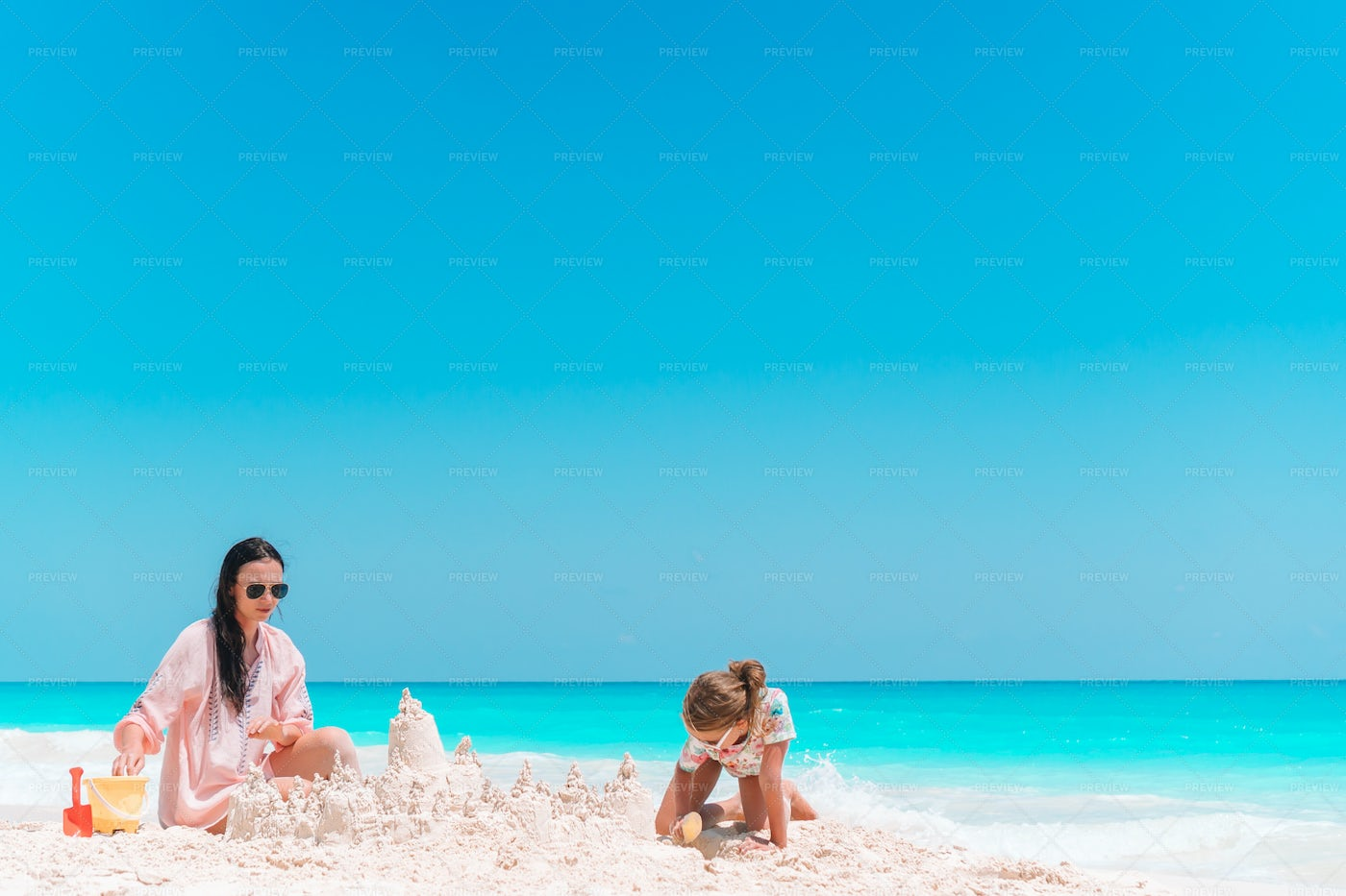 Building Sand Castles With Mom: Stock Photos