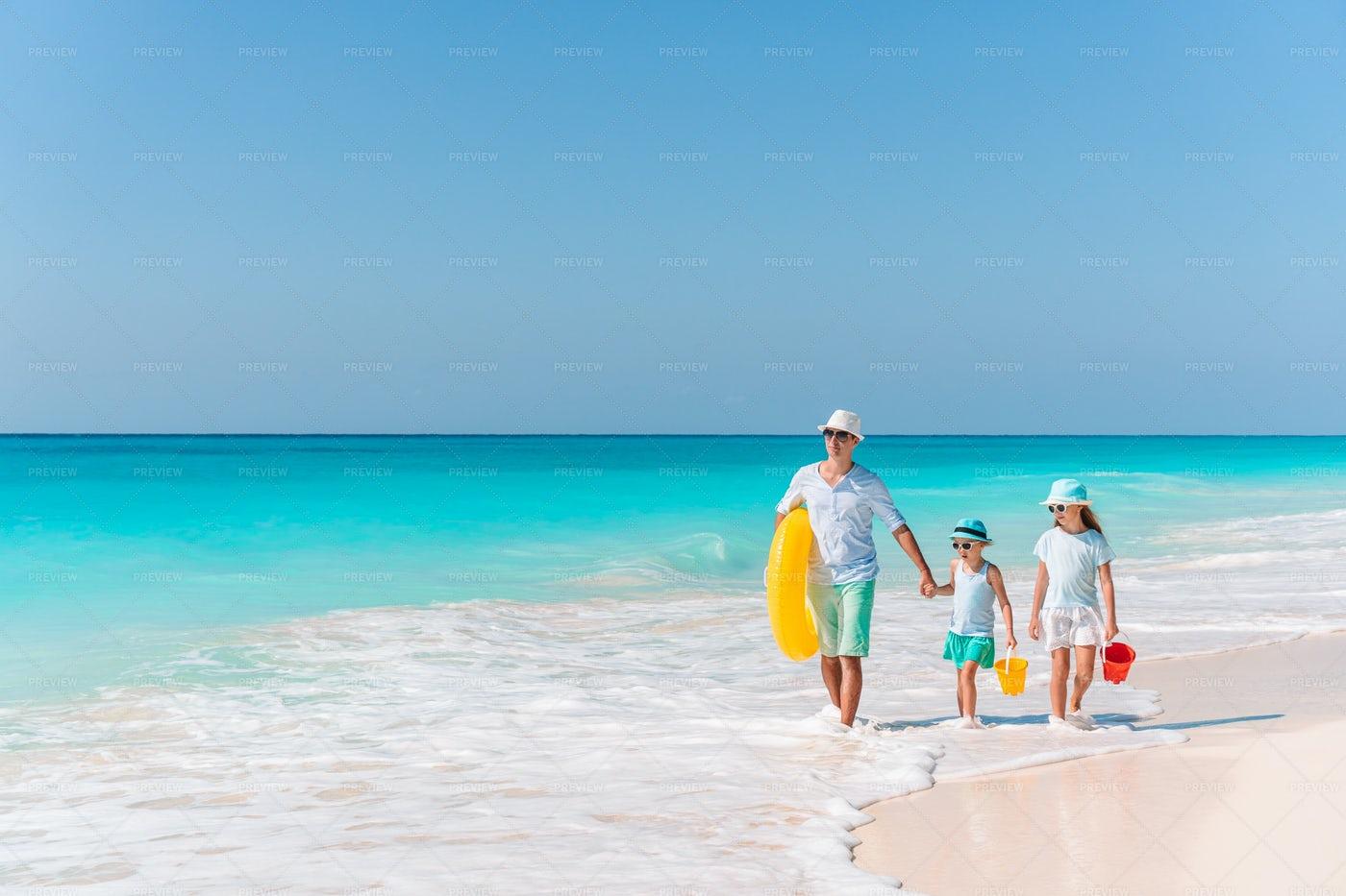 Family Walking On Beach: Stock Photos