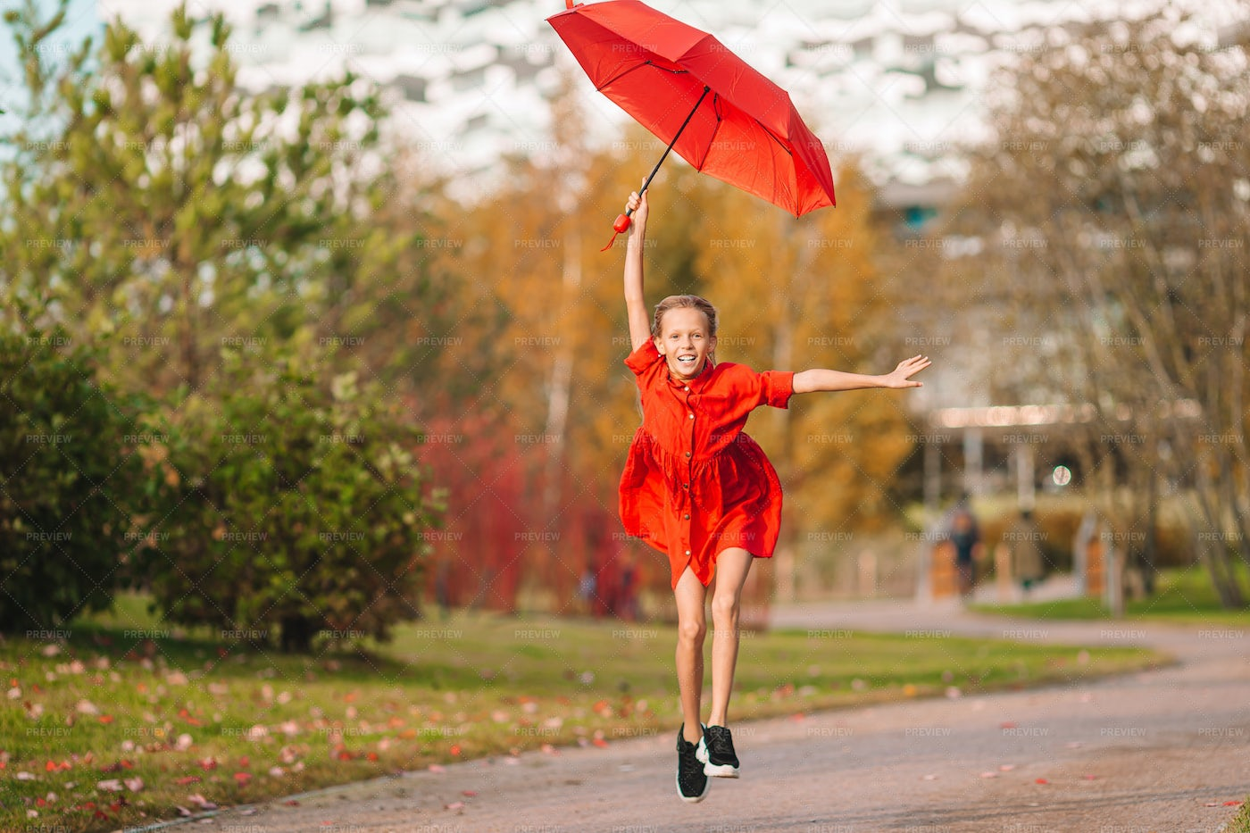 Leaping With Red Umbrella: Stock Photos