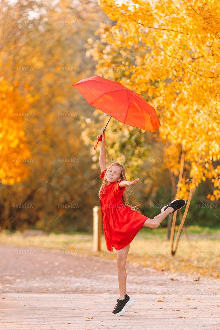 Child With Red Umbrella: Stock Photos