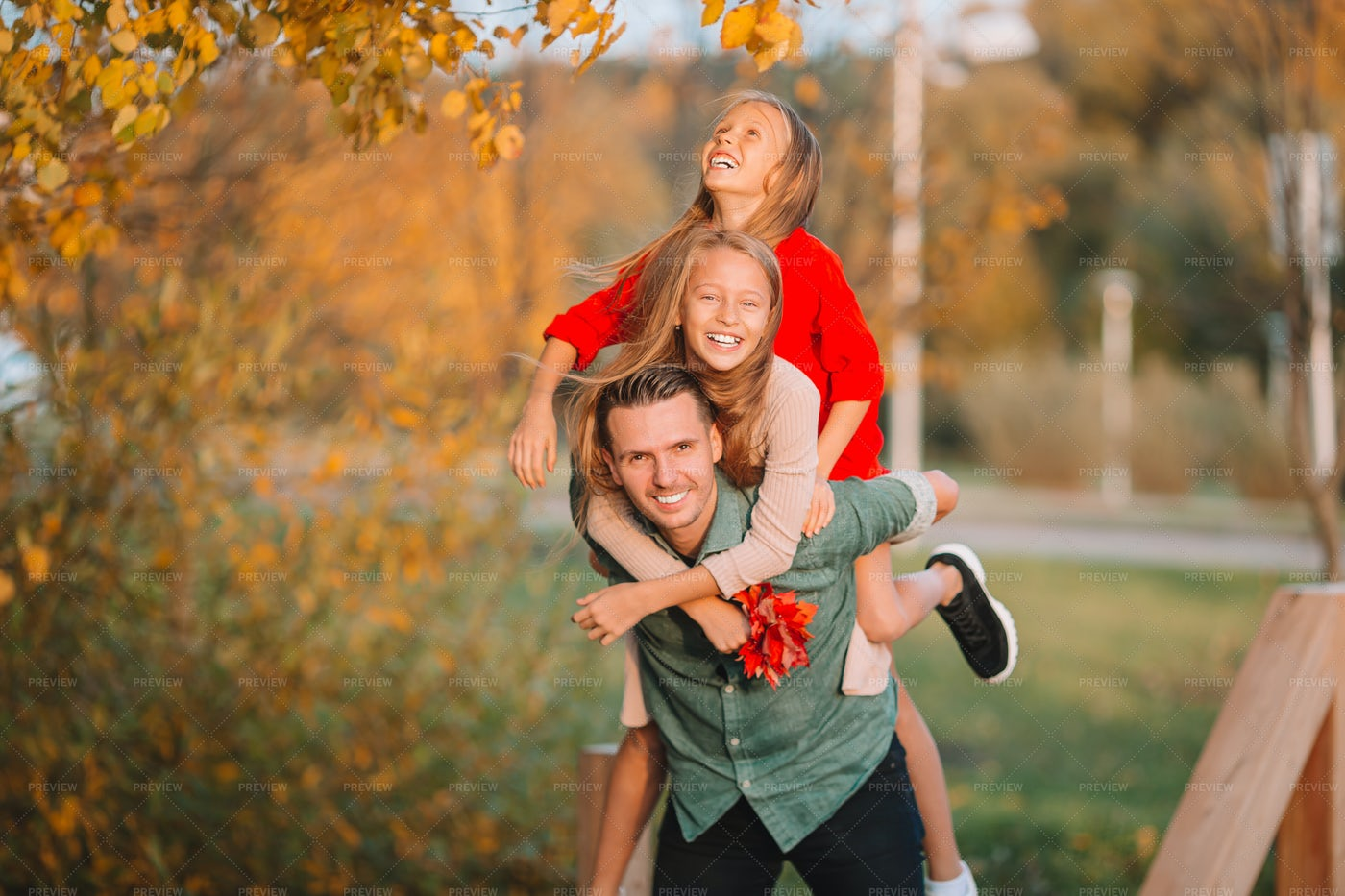 Carrying Daughters On Back: Stock Photos