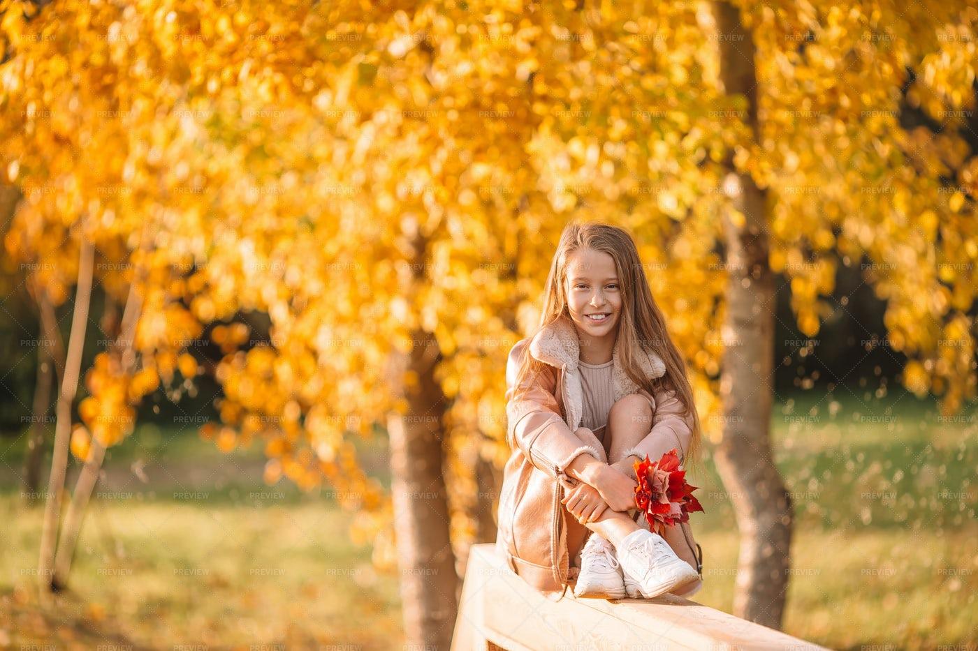 Girl Sitting On Wooden Railing: Stock Photos