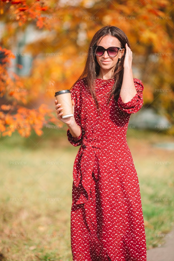 Drinking Coffee Outside In Fall: Stock Photos