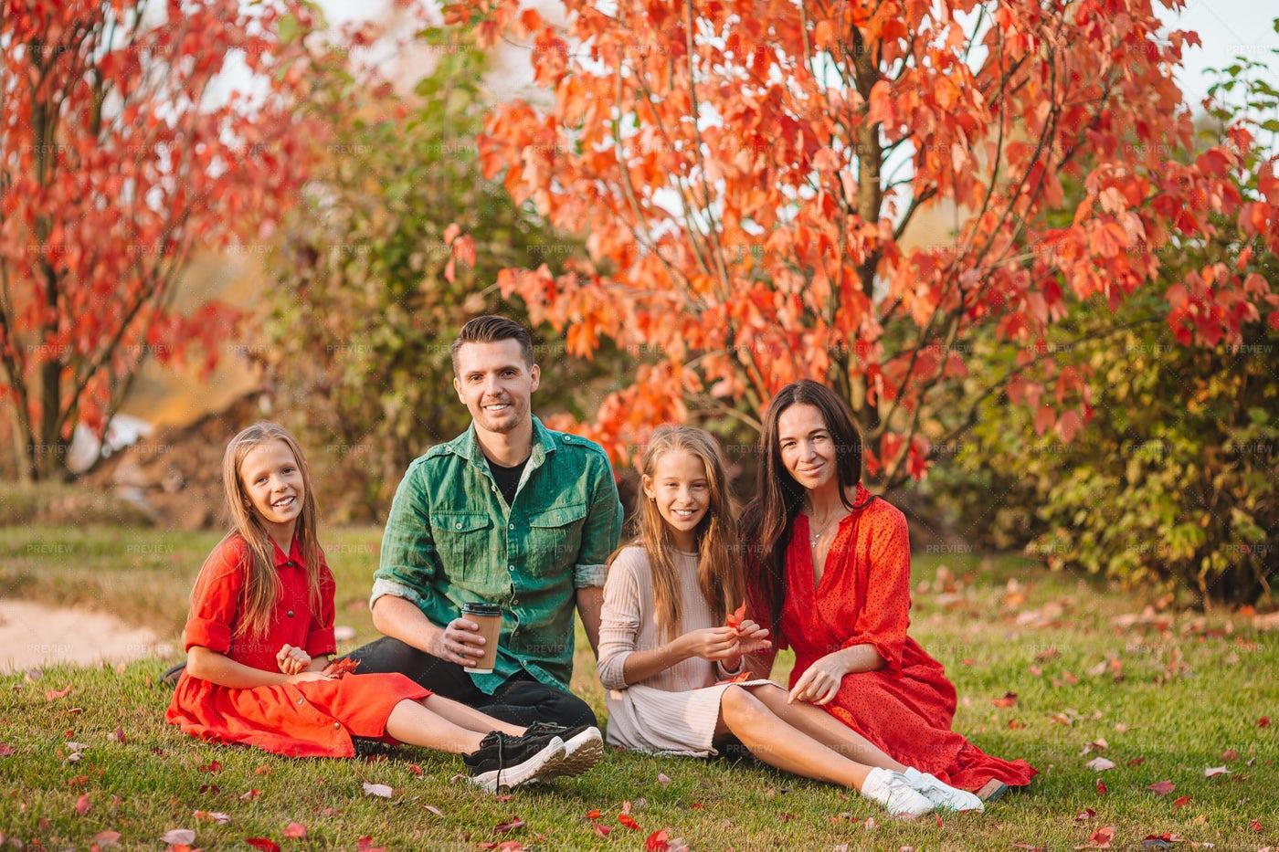 Happy Family In Autumn Park: Stock Photos