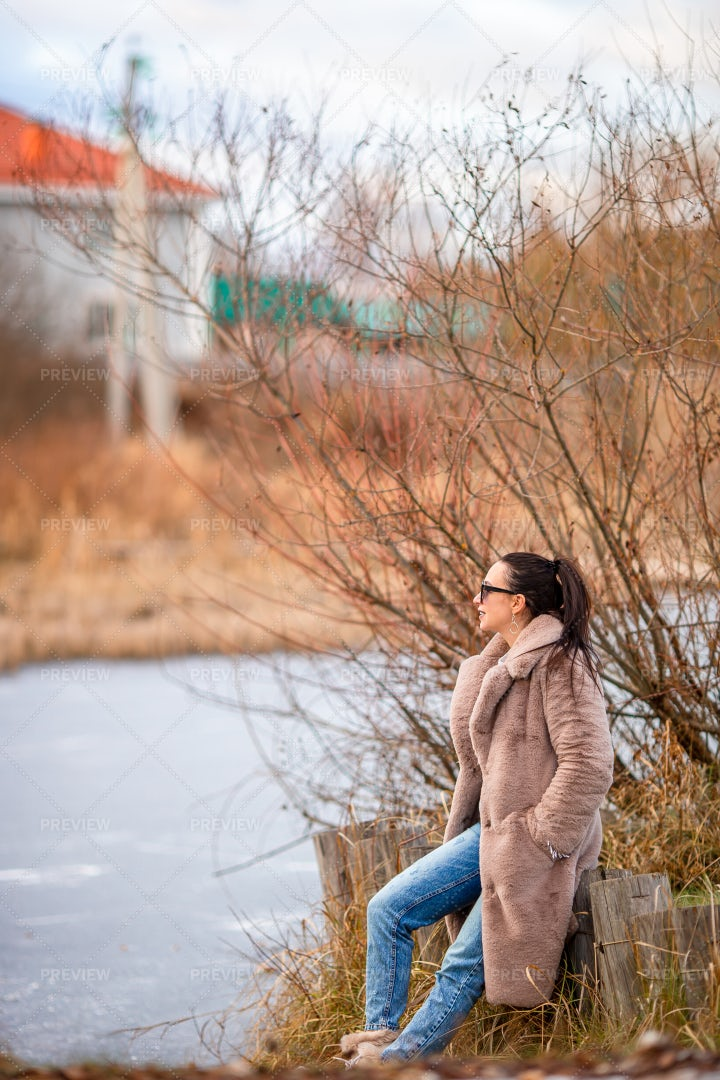 Sitting By Frozen Lake: Stock Photos