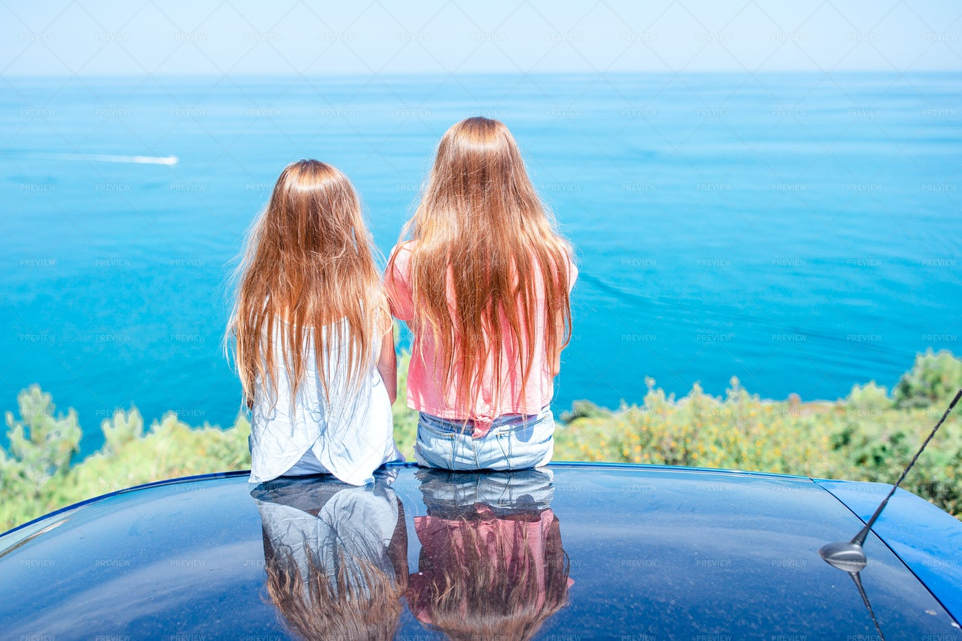 Sisters Sit On Car Roof: Stock Photos