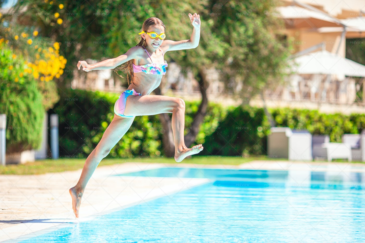 Jumping Into A Pool: Stock Photos