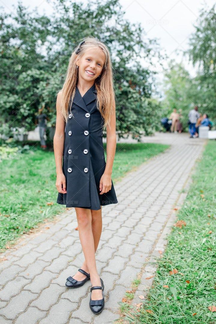 Little Girl In Black Dress: Stock Photos