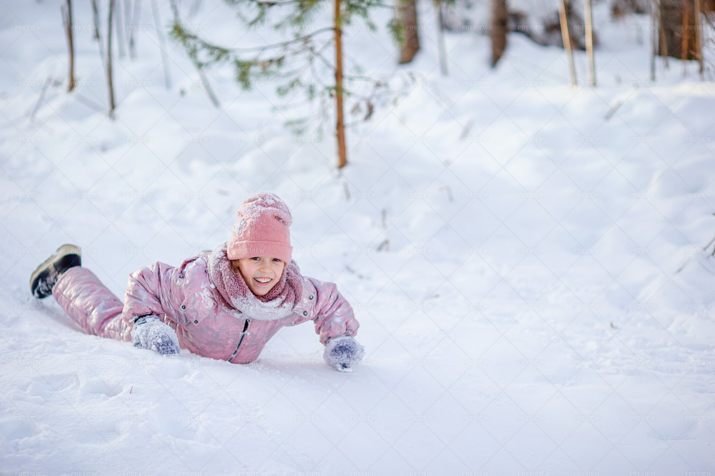 Child Fell On Icy Hill: Stock Photos
