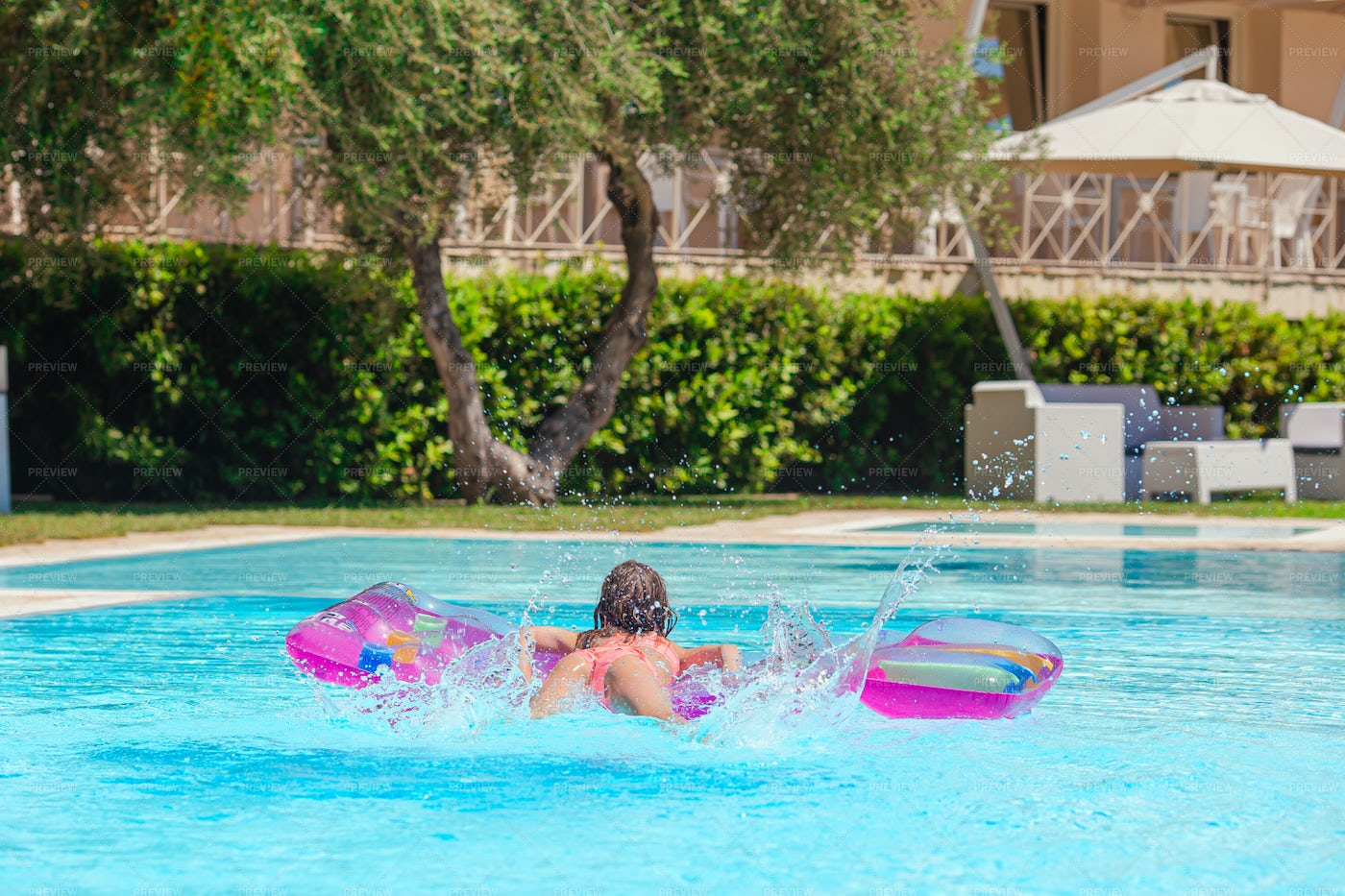 Jumping Onto Pool Float: Stock Photos