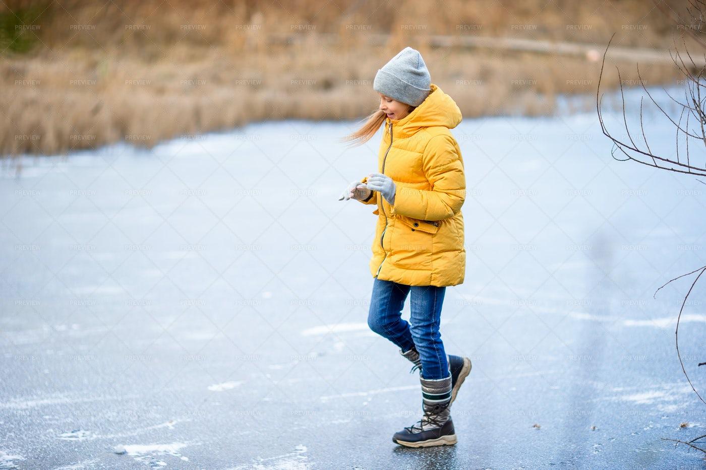 Sliding On Frozen Pond: Stock Photos