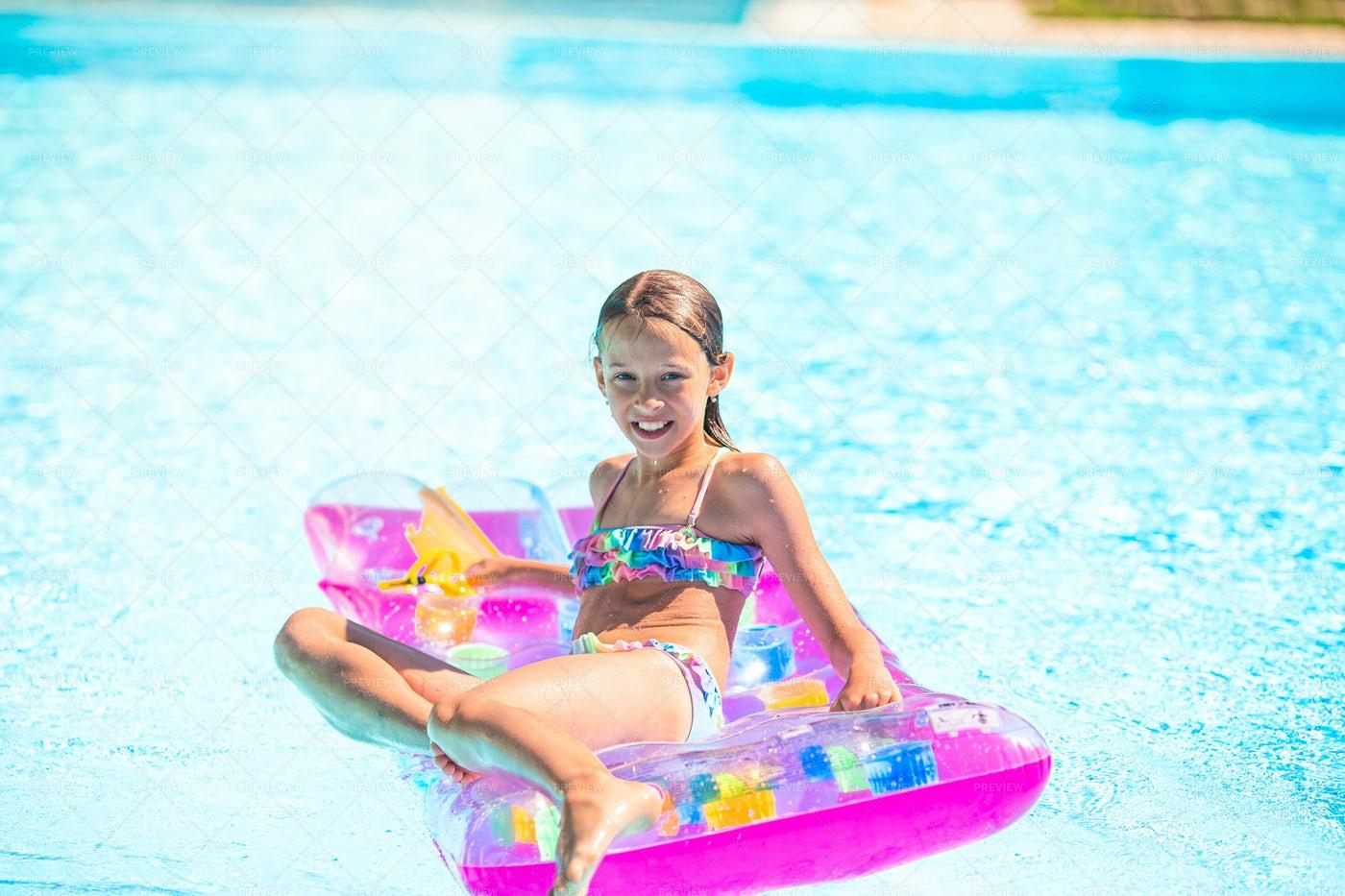 Girl Sitting On Inflatable Raft: Stock Photos