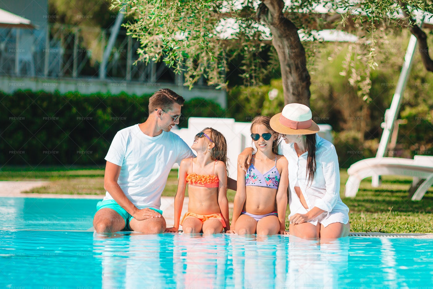 Family At The Pool: Stock Photos