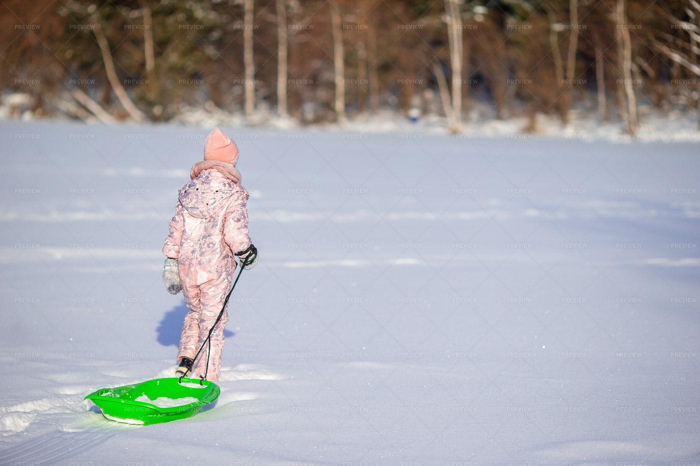 Girl Pulling Snow Sleigh: Stock Photos