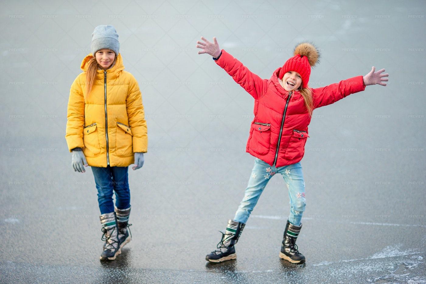 Sisters On Frozen Lake: Stock Photos