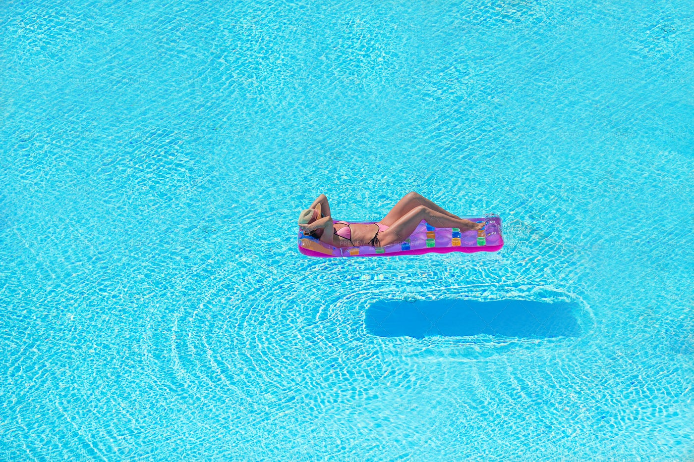 Woman Relaxing In A Pool: Stock Photos