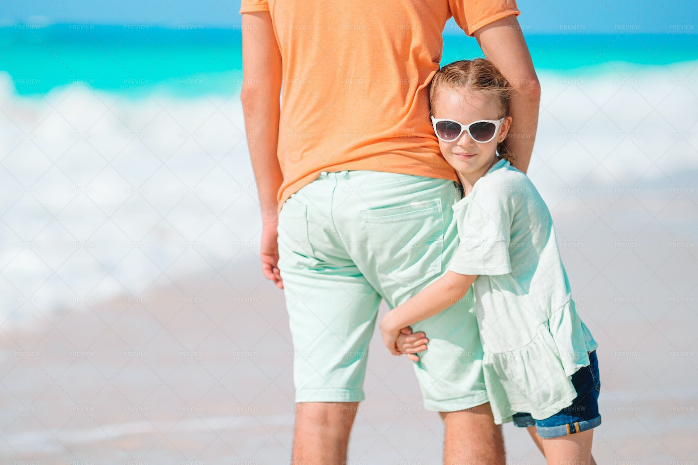 Girl And Father By The Sea: Stock Photos