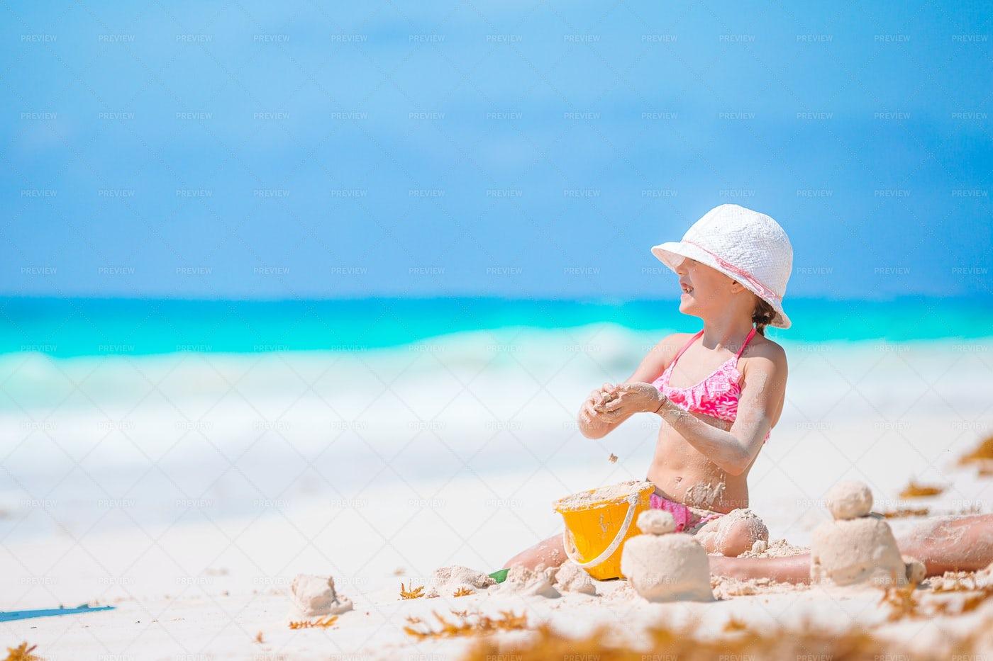Girl Building Sand Castles: Stock Photos