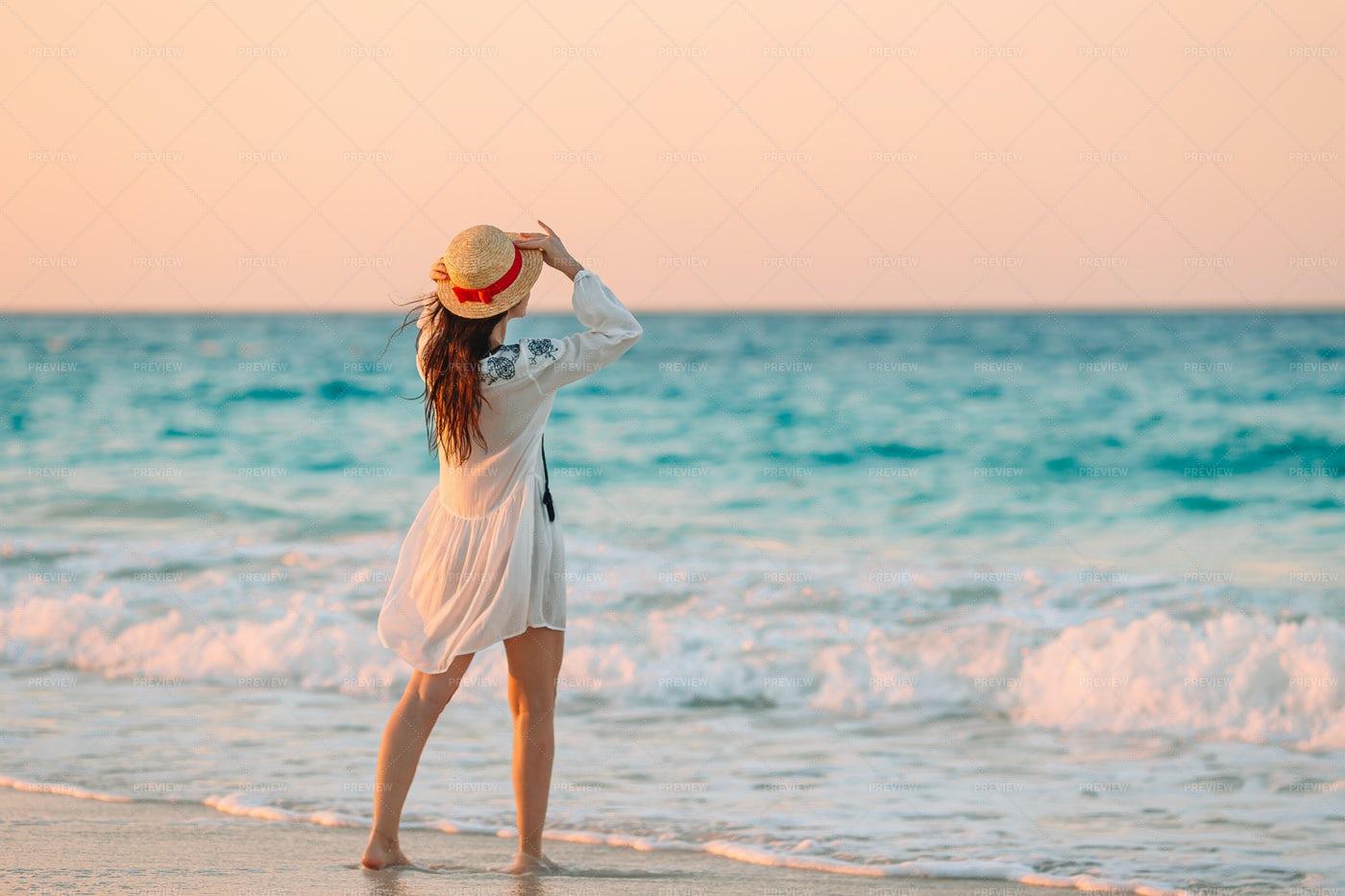 Woman On Windy Beach Shore: Stock Photos
