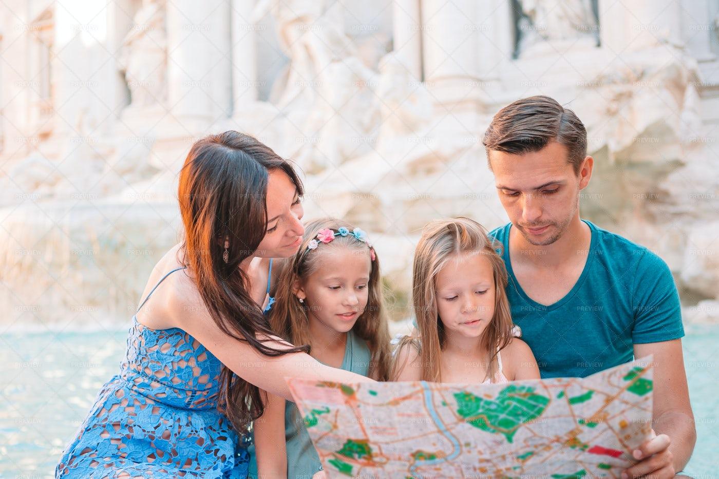 Family Reading A Map: Stock Photos