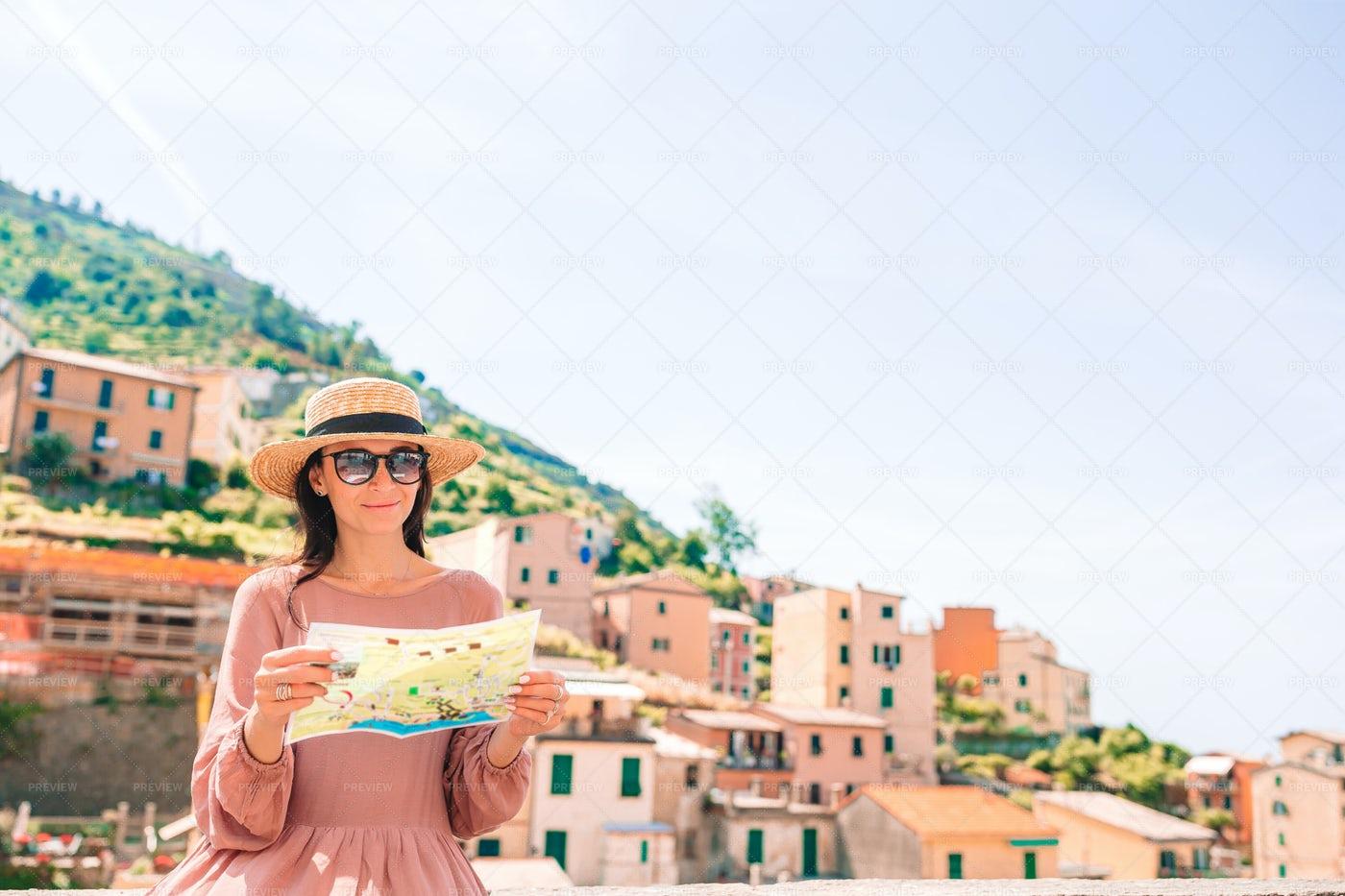 Tourist With Map In Riomaggiore: Stock Photos
