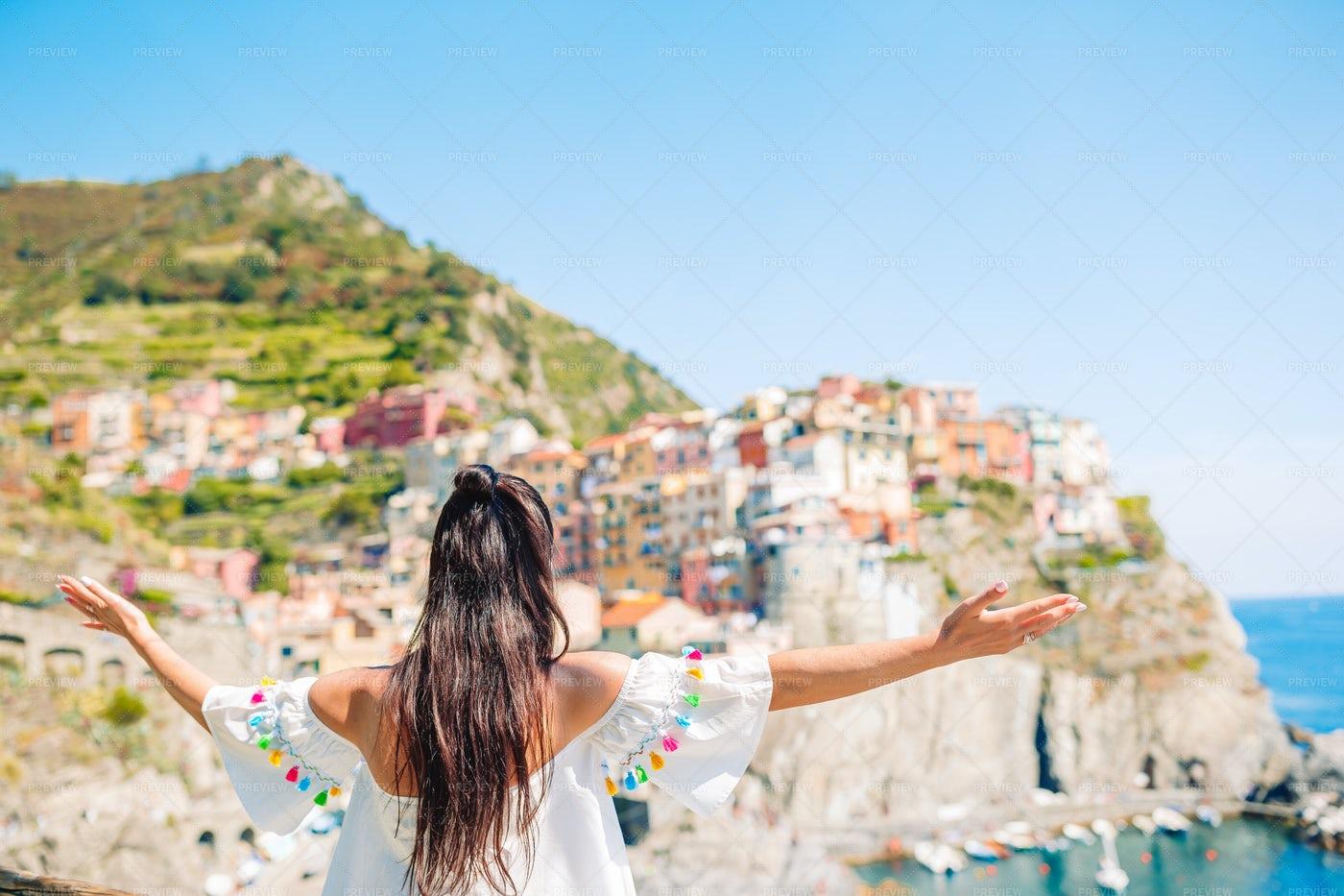 Tourist Enjoying The View Of Manarola: Stock Photos