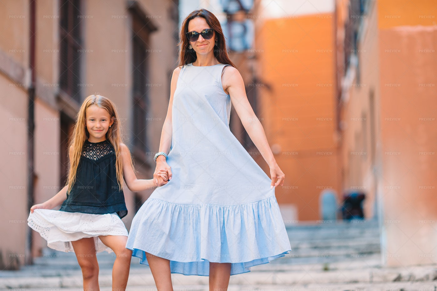 Mother And Daughter Walking: Stock Photos