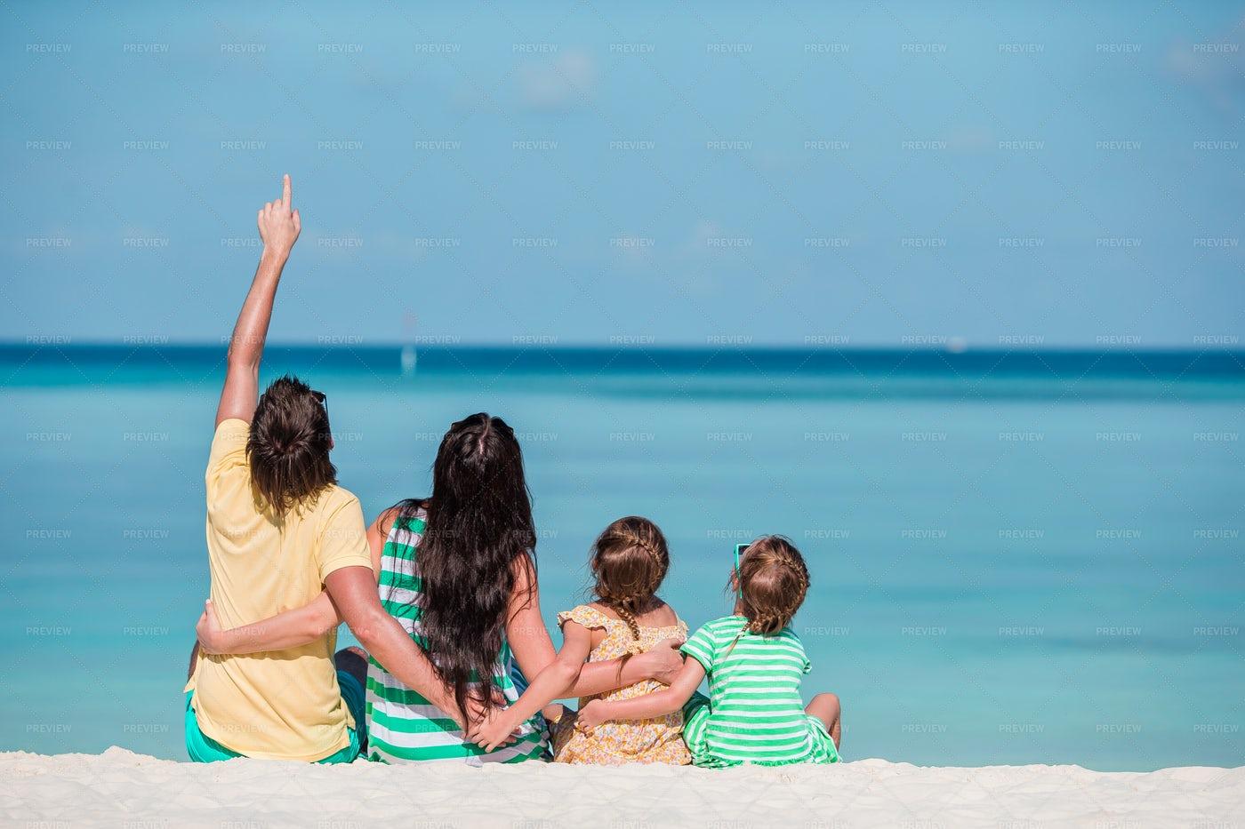 Family Viewing The Sea: Stock Photos