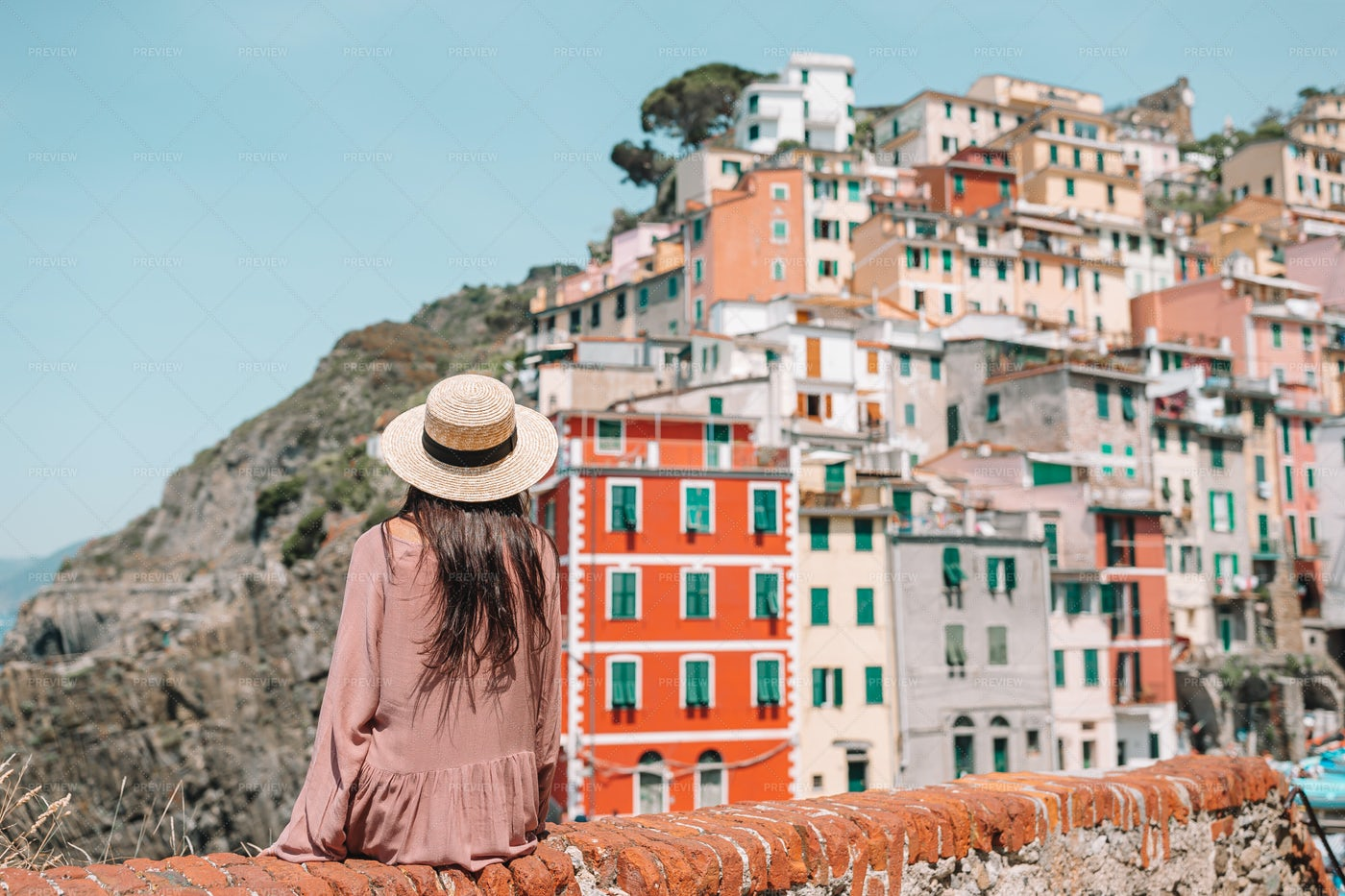 Woman With An Old Village View: Stock Photos