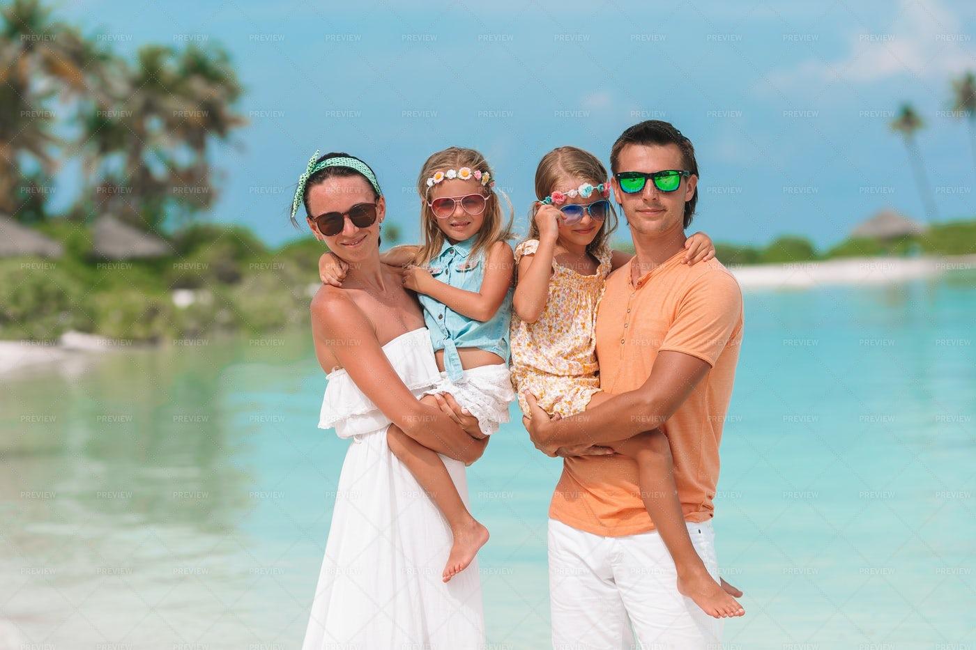 Family On Tropical Beachfront: Stock Photos