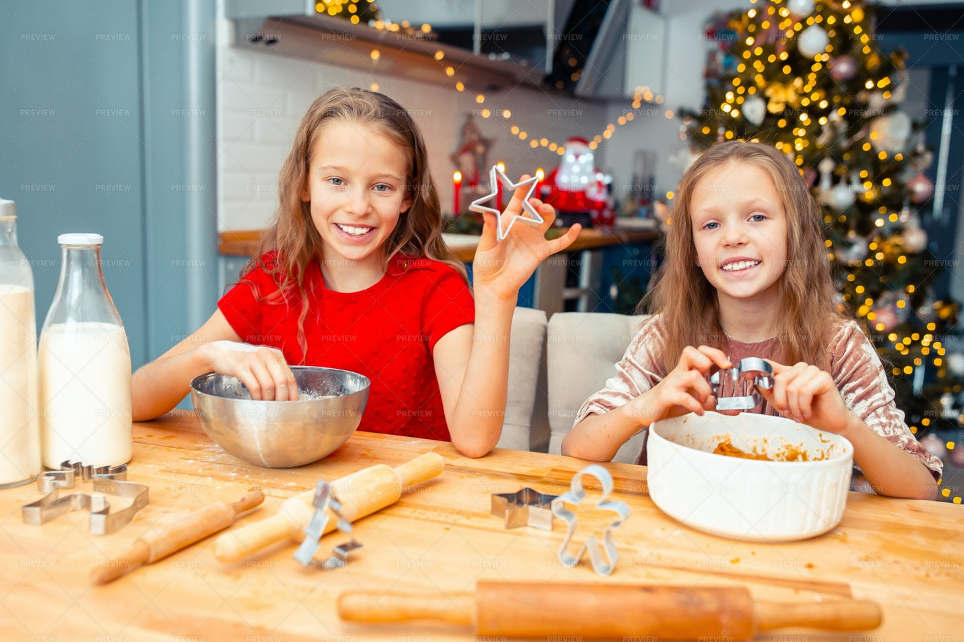 Cutting Out Gingerbread Men: Stock Photos