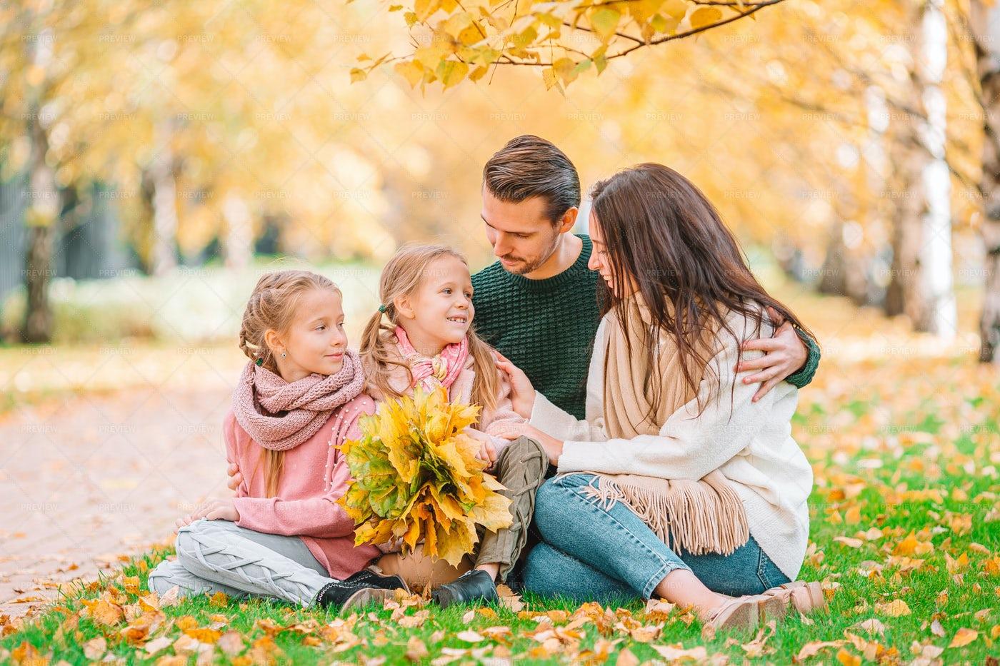 Family Of Four In Autumn Park: Stock Photos
