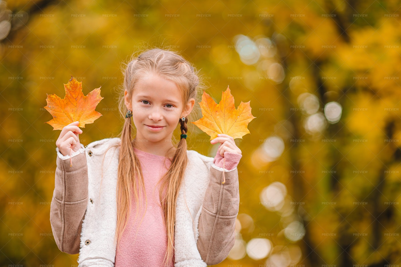 Little Girl At The Park In Fall: Stock Photos
