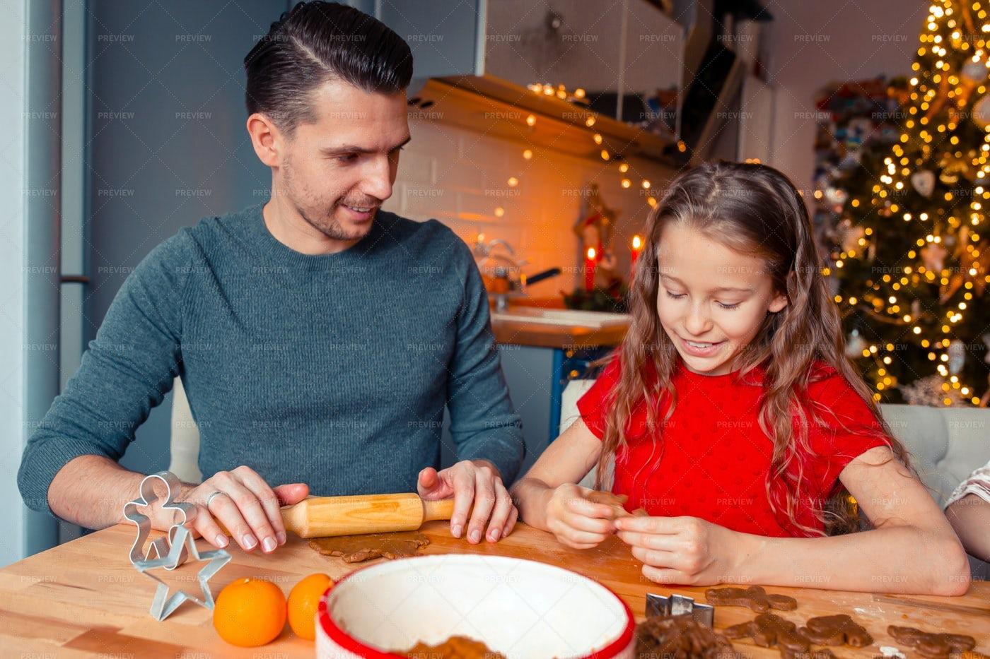 Family Baking Gingerbread Cookies: Stock Photos