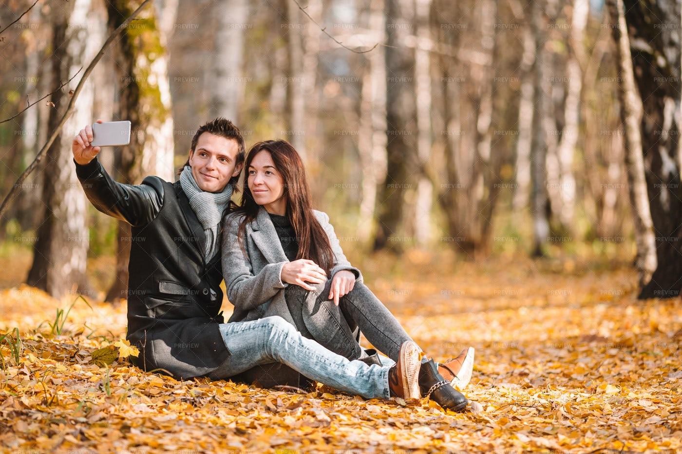 Couple Taking Selfie In Park: Stock Photos