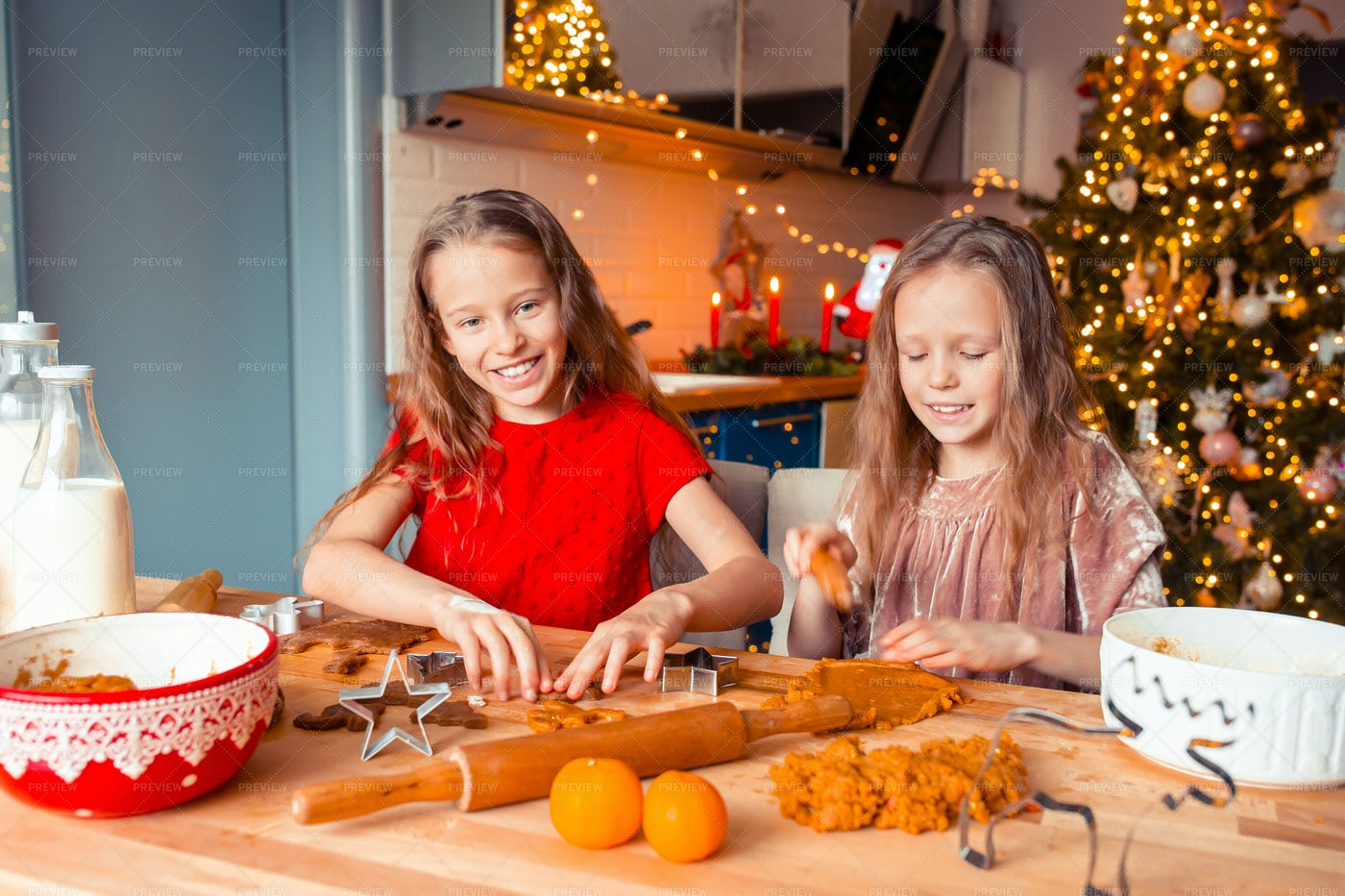Sisters Making Gingerbreads: Stock Photos