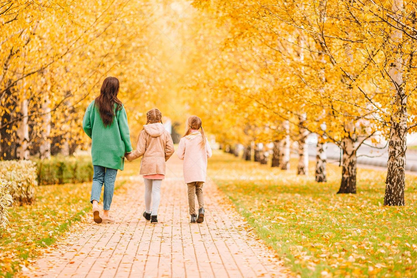 Walking Through Park With Mom: Stock Photos