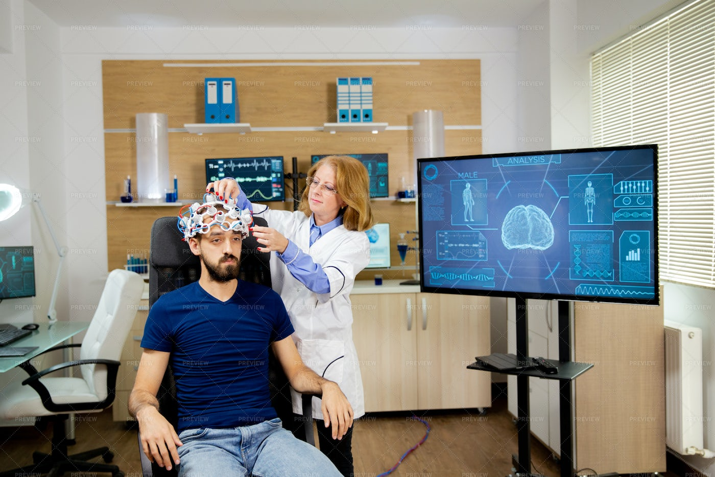 Doctor Tracking Transmitted Data: Stock Photos