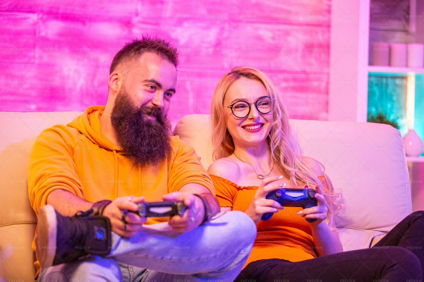 Gaming Couple On Couch: Stock Photos
