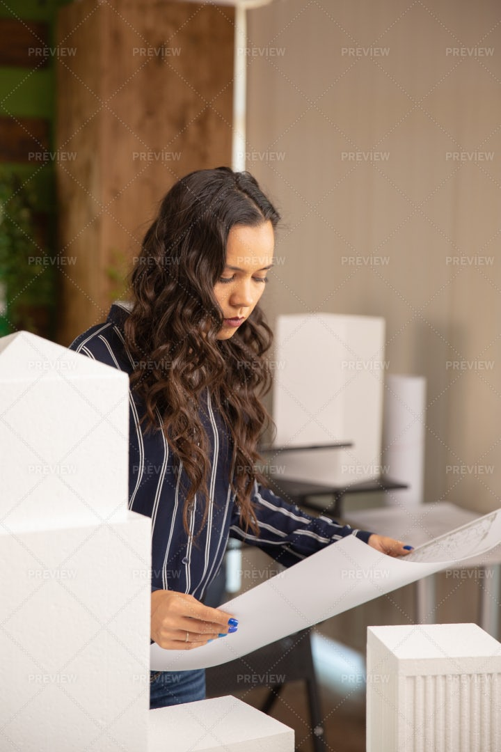 Checking Model With Blueprints: Stock Photos