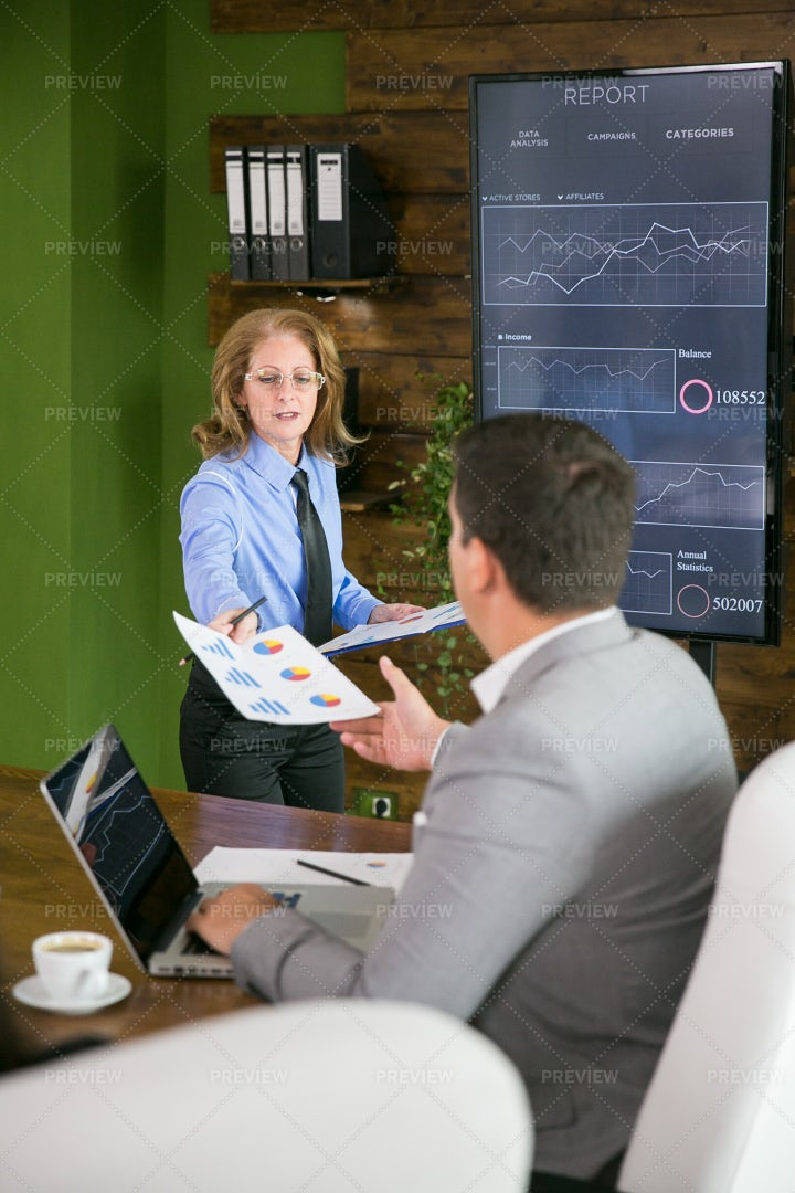 Handing Out Documents: Stock Photos
