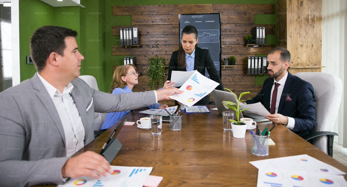 Passing Out Meeting Documents: Stock Photos
