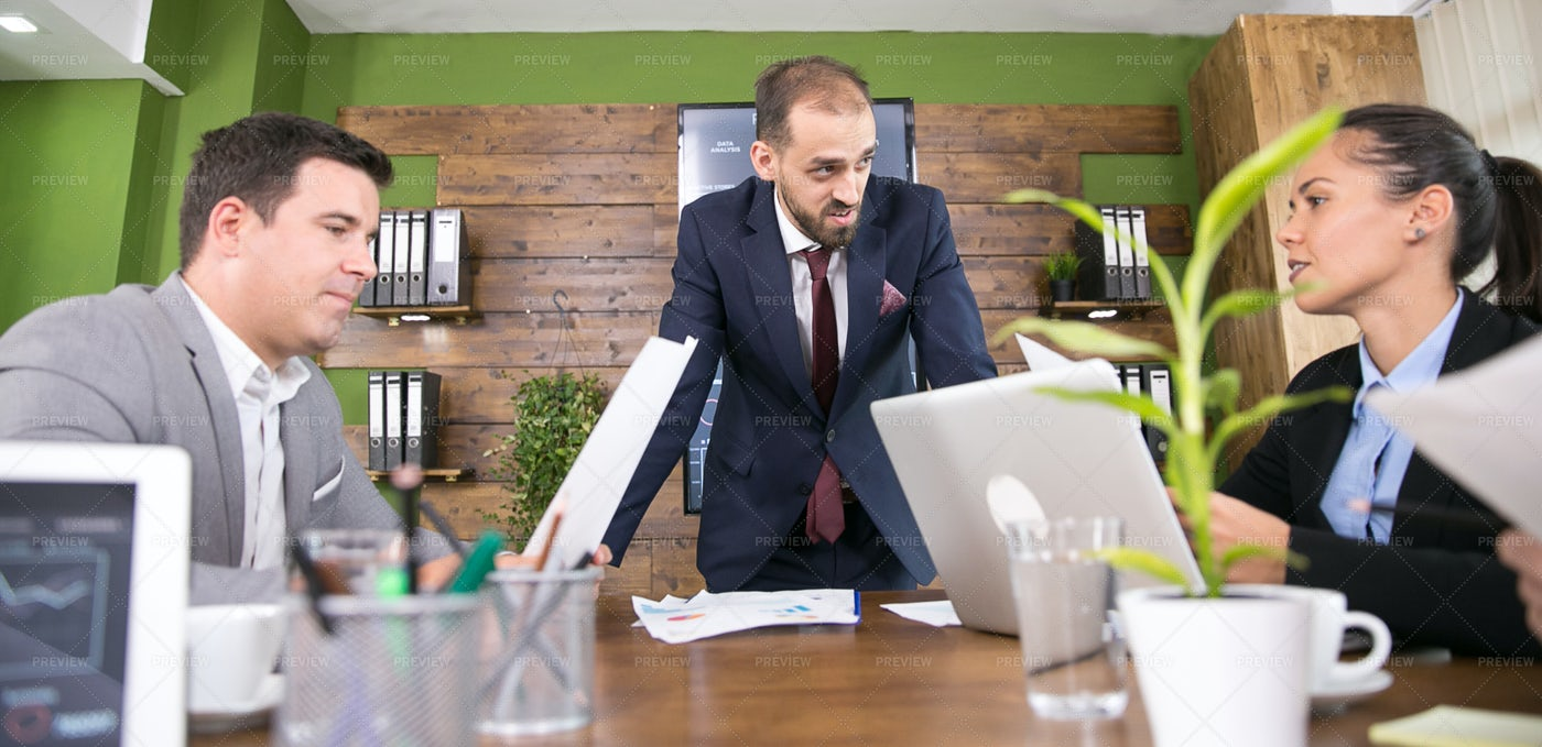Businessman Leads Table Discussion: Stock Photos