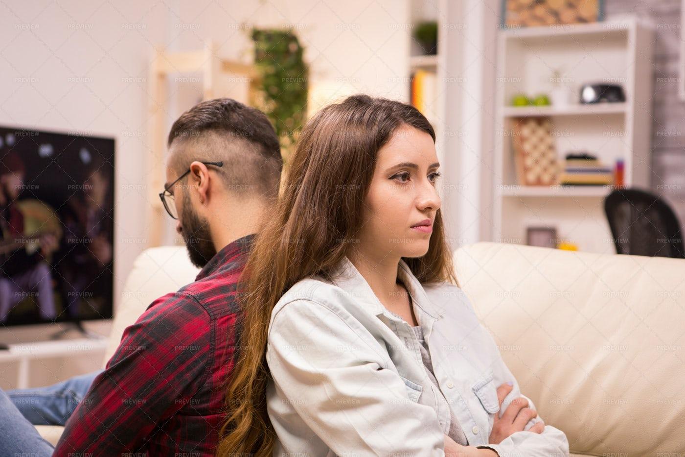 Caucasian Couple Sitting Back To Back: Stock Photos