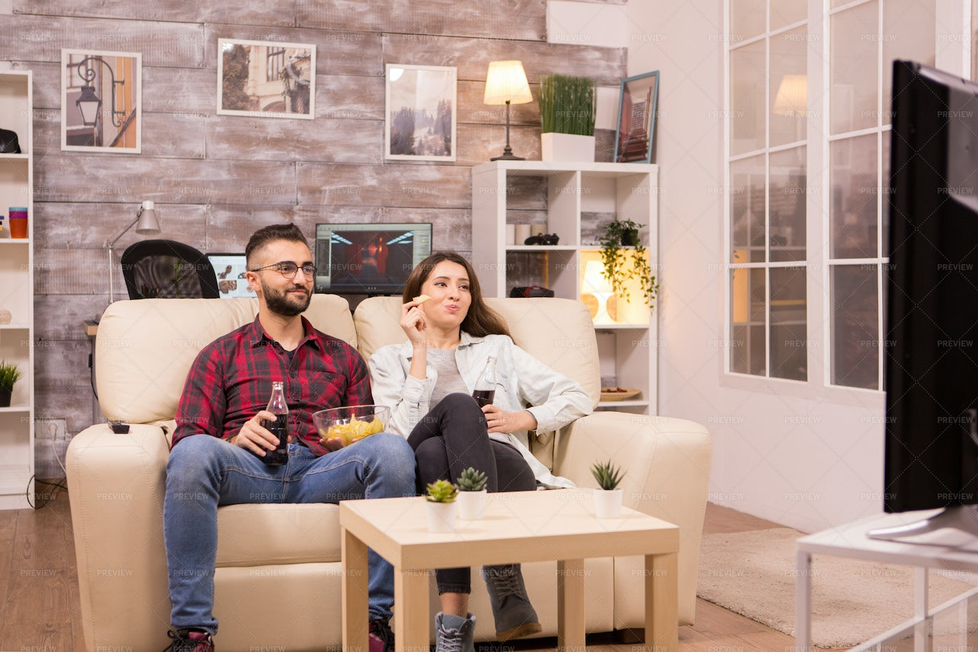 Watching TV And Eating Junk: Stock Photos