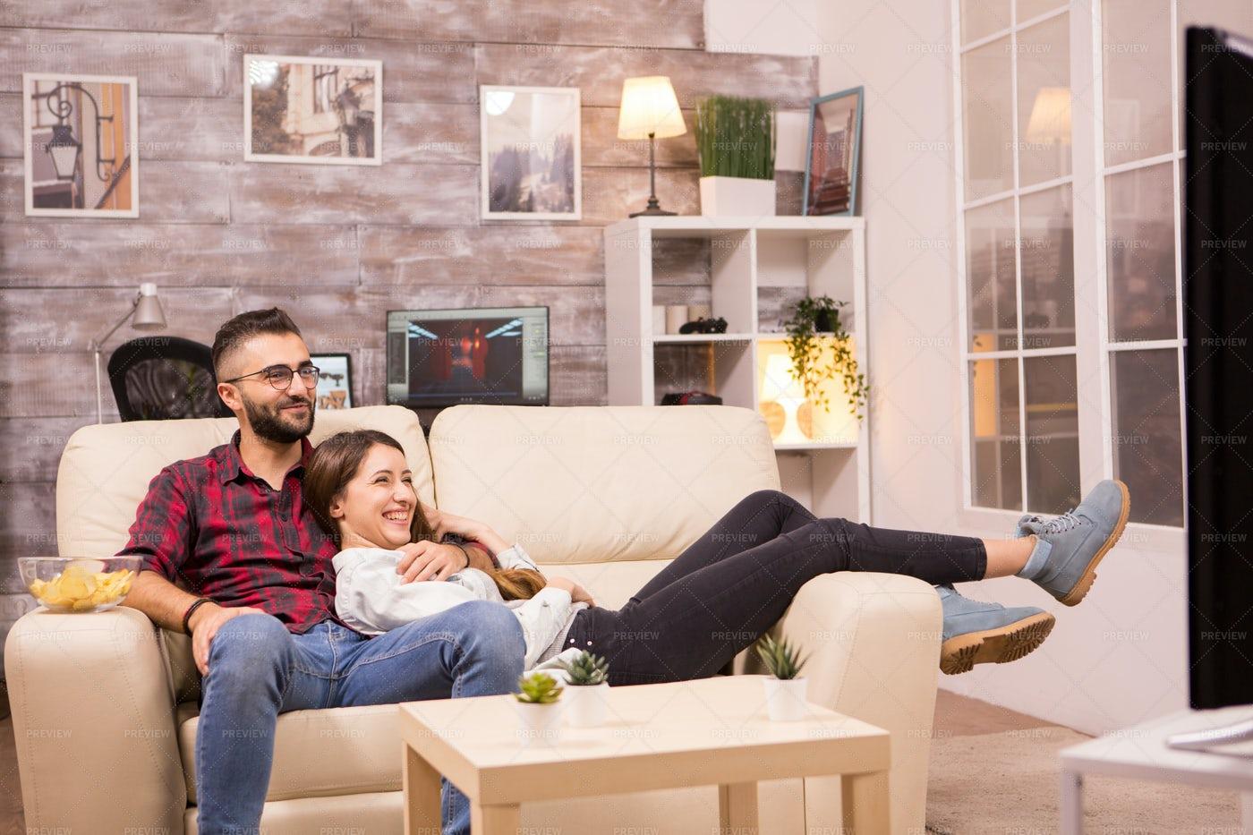 Couple Relaxing On Sofa: Stock Photos