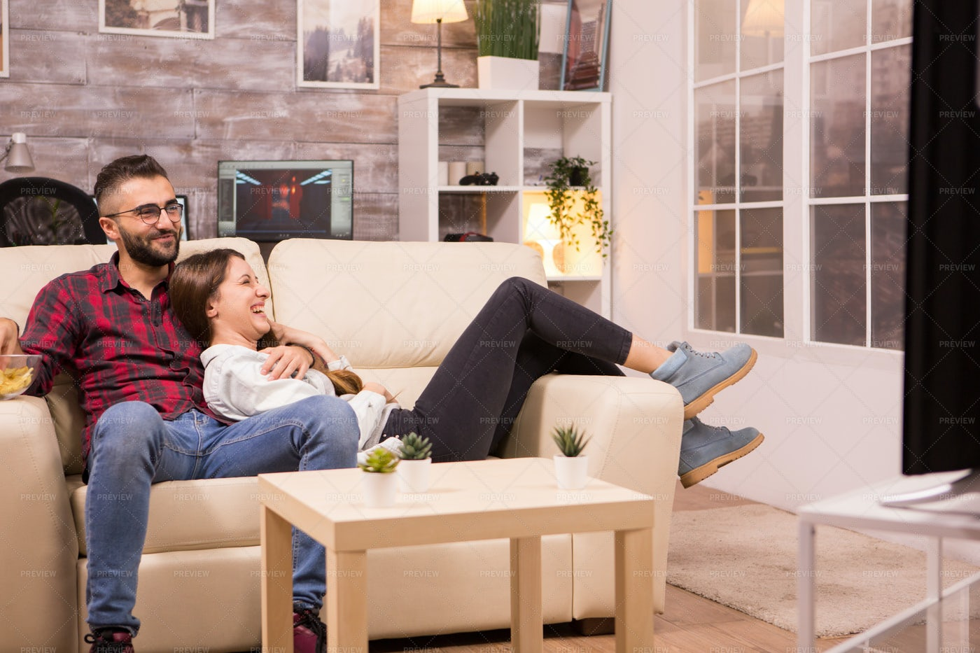Couple Laughing While Watching A Movie: Stock Photos
