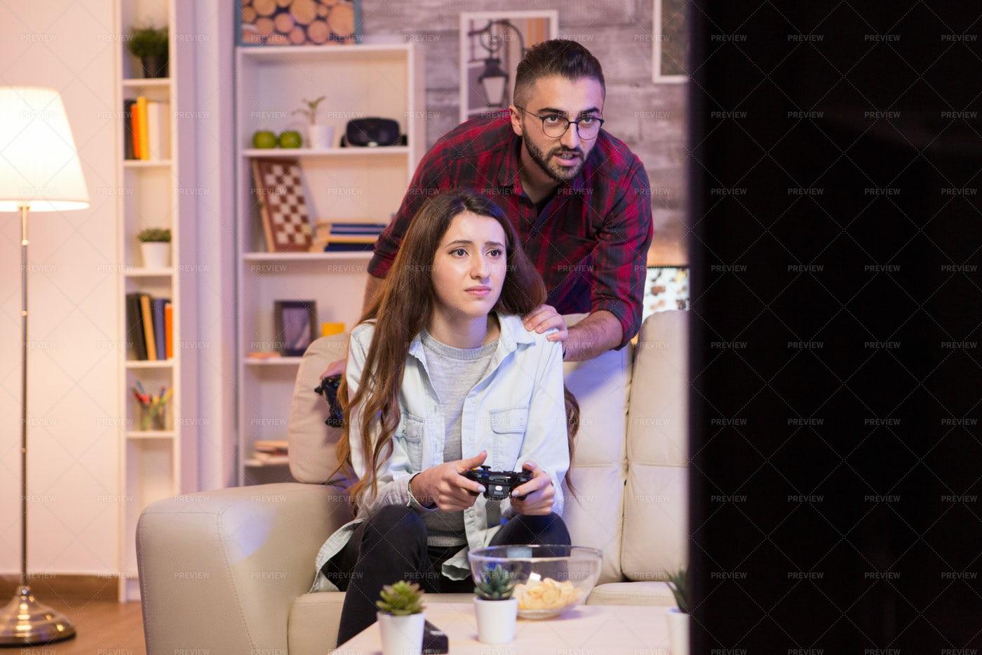 Boyfriend Helping His Girlfriend To Win: Stock Photos