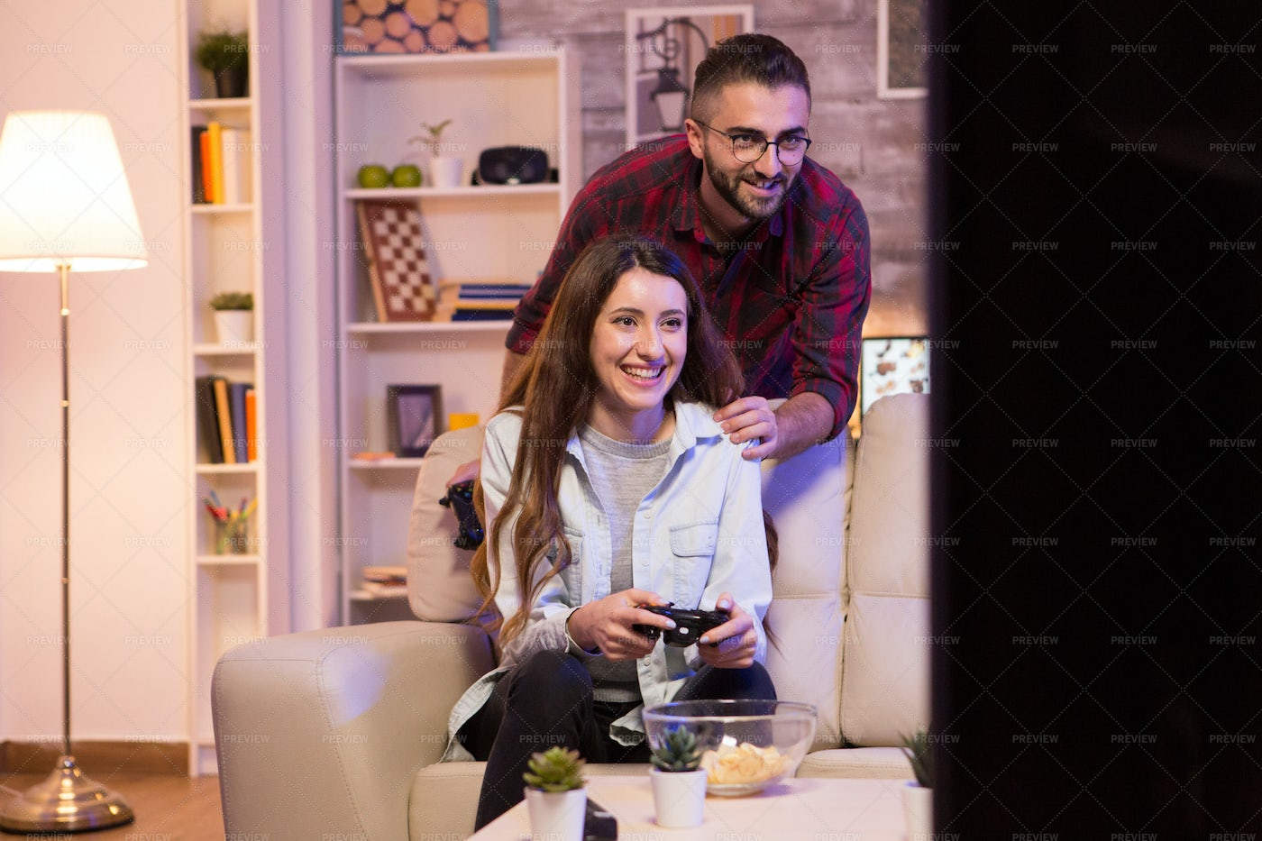Excited Couple Playing Video Games: Stock Photos