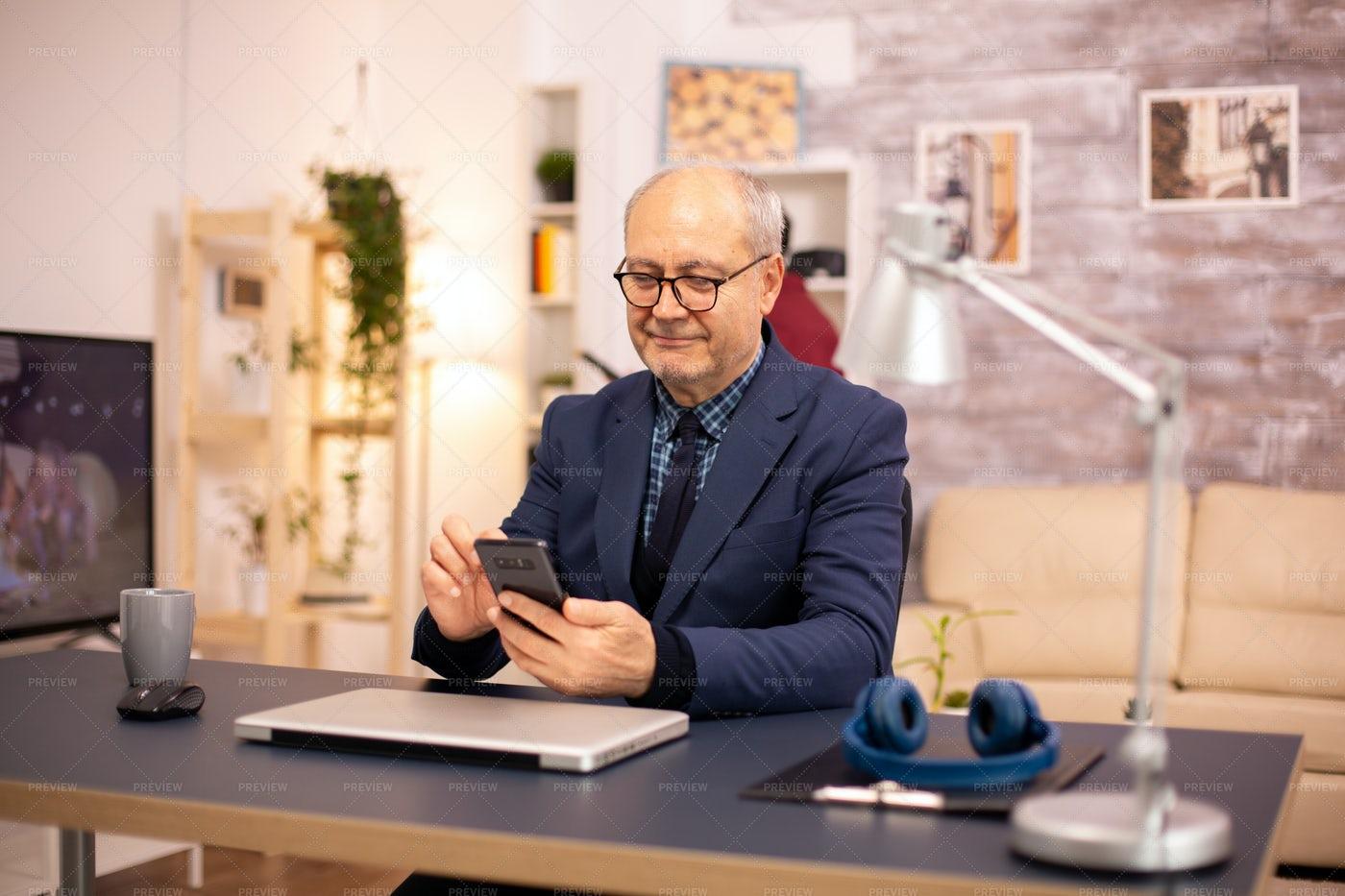 Old Man Browsing Phone: Stock Photos